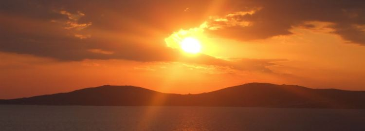 Sunset view from Mykonos Grand Hotel looking towards Delos, birthplace of Artemis and Apollo