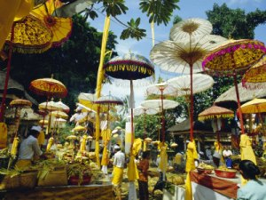francis-robert-parasols-in-taman-pile-hindu-temple-on-koningan-day-bali-indonesia
